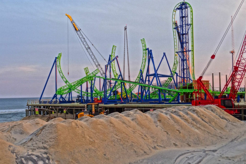 Roller coaster assembly on Jersey Shore pier advances